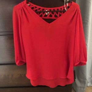 Flowy red blouse. Open back and shoulders